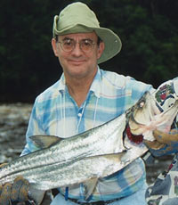 Arthur Topilow, MD, holding a payara, a jungle dragon fish of Venezuela